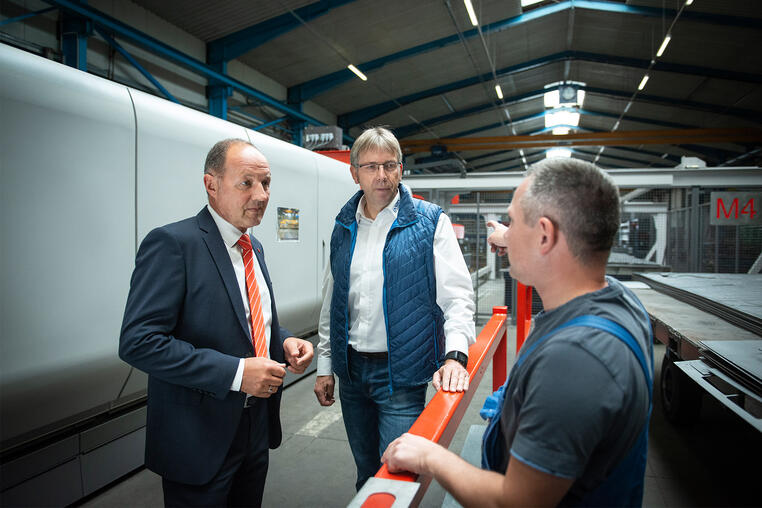 """Jörg Zechel, Bystronic Sales Manager North, (on the left) says: """"The turnkey solution comprising laser cutting system, automation, software, and service was developed in close cooperation between Bystronic and Langen CNC Metalltechnik. The package we implemented is unique on the market."""""""